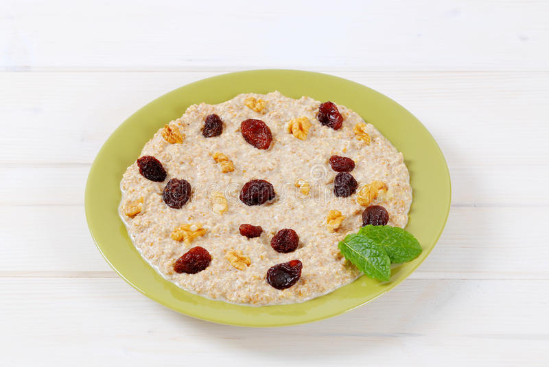 Download Plate of oatmeal porridge stock photo. Image of white - 83705918