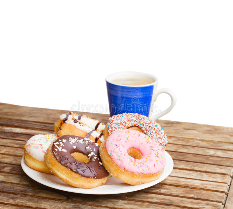 Free Plate Of Donuts And Blue Coffee Mug Stock Photos - 33599203