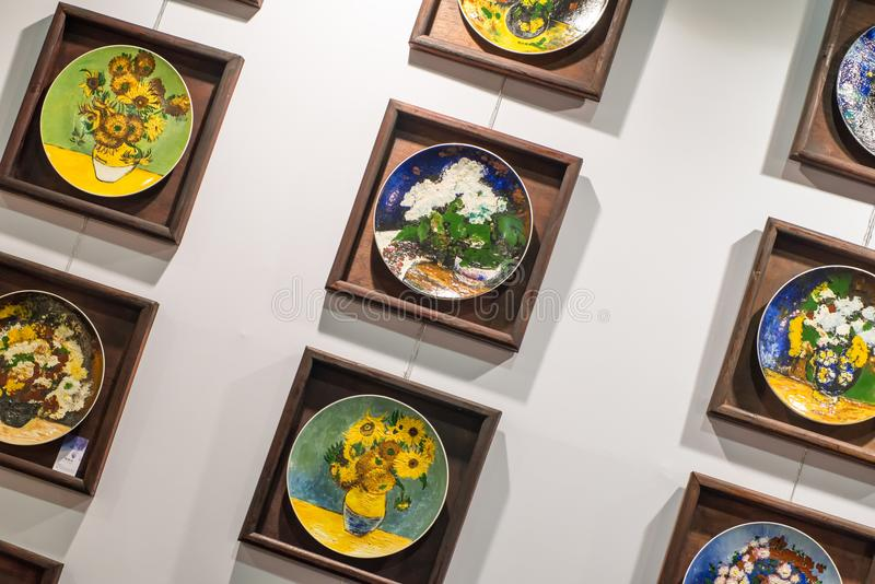 Plate painting. China plate oil painting in wooden frames stock photos