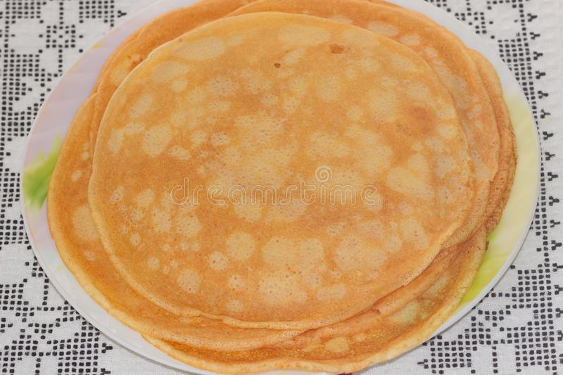 Plate with pancakes on a patterned towel stock photo