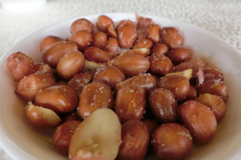 A plate of peanuts with salts. From a Chinese restaurant in Hong Kong. The peanuts are usually served as snacks and charged at a high price royalty free stock images