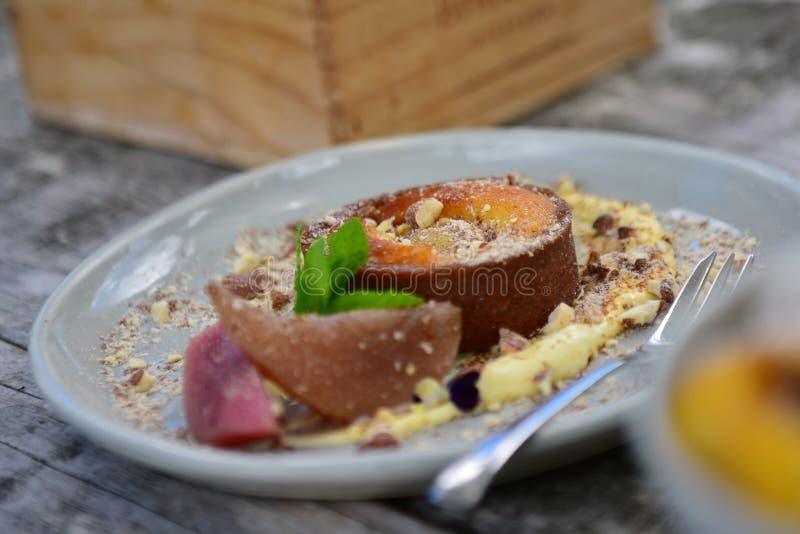 Plate of pear, honey & almond tart dessert stock photo