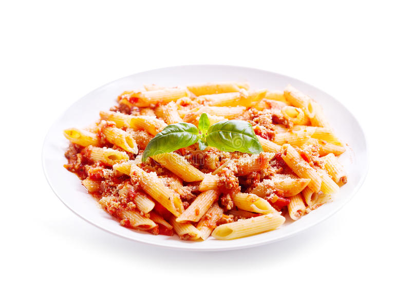 Plate of penne pasta bolognese on white background stock image
