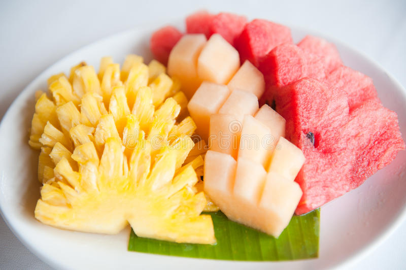 A plate of Pineapple, Cantaloupe and Watermelon. A plate of famous tropical fruits : Pineapple, Cantaloupe and Watermelon royalty free stock images