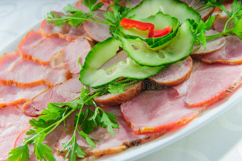 Plate of pork sliced meat. royalty free stock photos