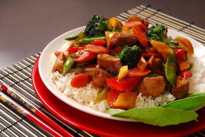 Plate of pork stir fry. A plate of pork stir fry with vegetables stock photo