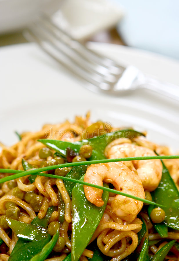 A plate of prawn stir fry noodles royalty free stock photos