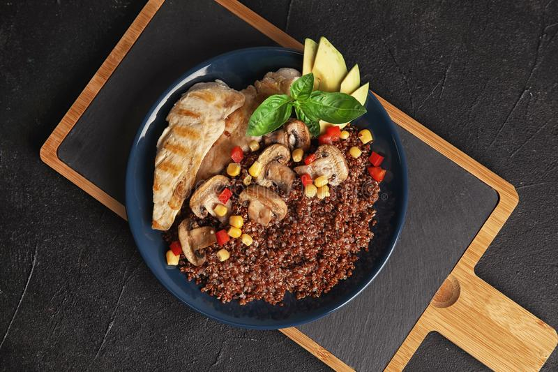 Plate with quinoa and garnish on table. Top view royalty free stock images
