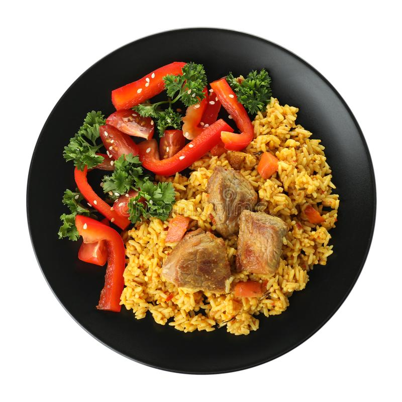 Plate with rice pilaf and meat on white, top view stock photography