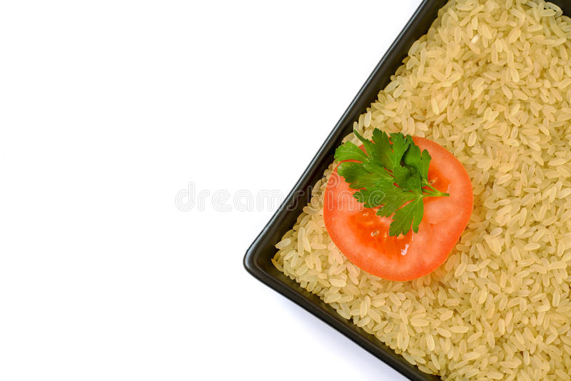 Plate with rice and tomato slice. Isolated on white background stock photography