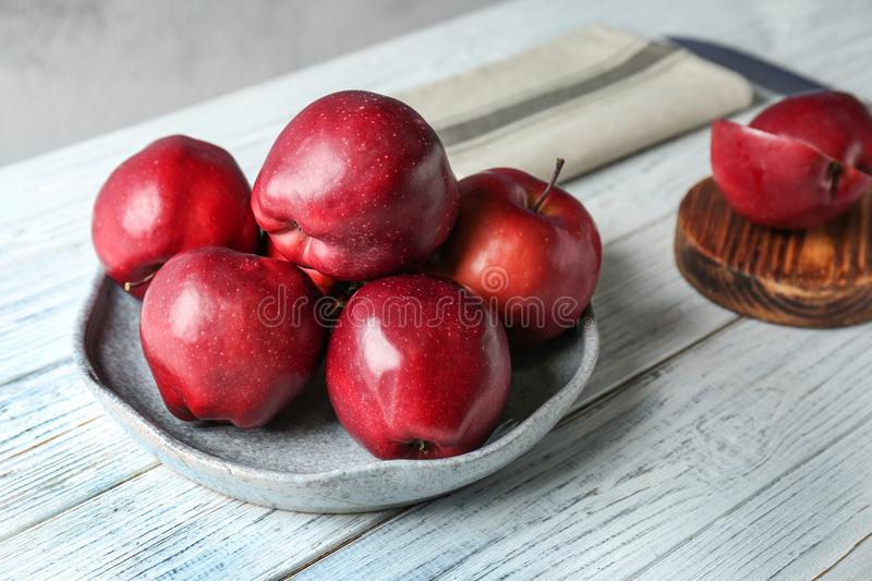 Plate with ripe red apples royalty free stock photos