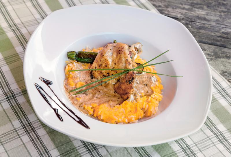 Roast chicken with rice dinner plate stock images