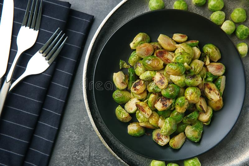 Plate with roasted brussel sprouts. On table stock photo