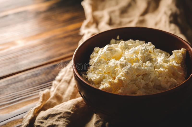 Plate with rustic cottage cheese close-up space for copy royalty free stock image