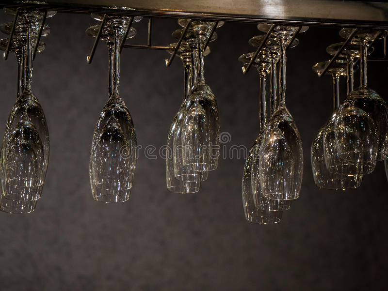 Clear champagne glasses on hanging rank. Clear champagne glass on hanging rank in the resturant royalty free stock photos