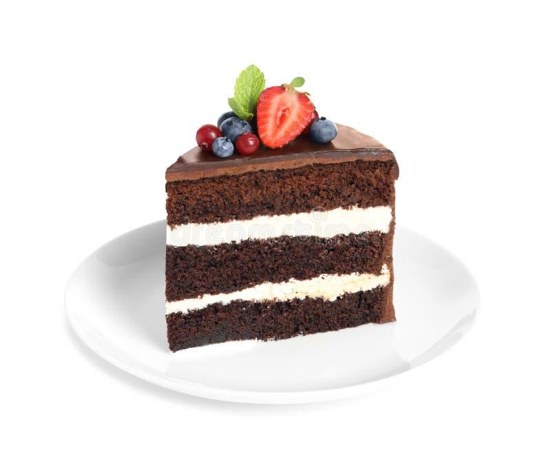 Plate with slice of chocolate sponge berry cake stock photo