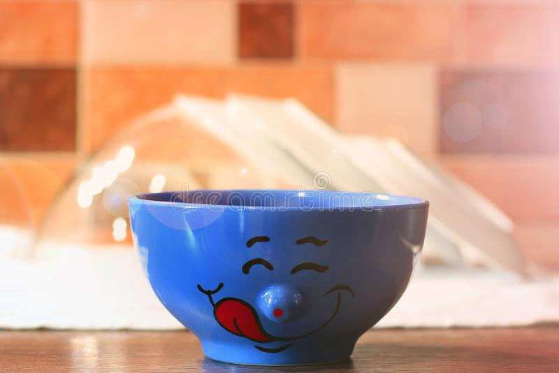 Plate with a smile in the kitchen royalty free stock photos