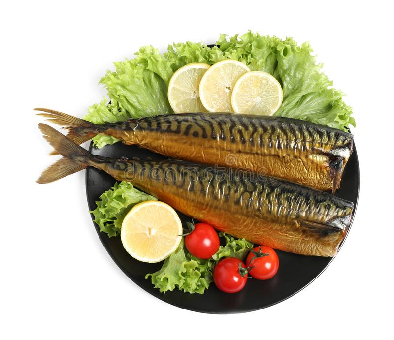 Plate with smoked fish on white, top view royalty free stock photos