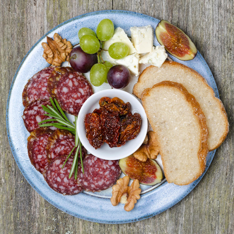 Download Plate With Snacks Sausage Cheese Nuts And Fruit Stock Image - Image & Plate With Snacks Sausage Cheese Nuts And Fruit Stock Image ...