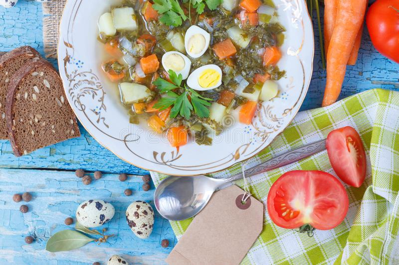 Plate with sorrel soup, bread and different vegetables. Top view stock images