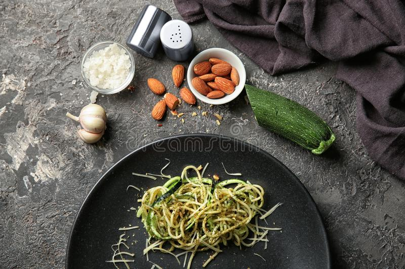 Plate of spaghetti with zucchini and pesto sauce on table royalty free stock photos