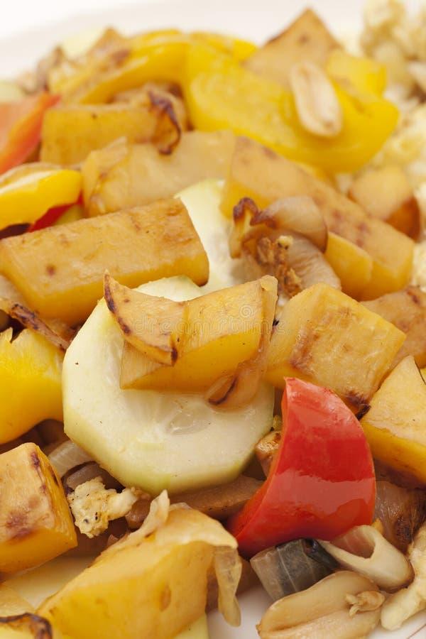 Plate of stir fry vegetables. Close up photography ofstir fry vegetables.  Vertical image stock image