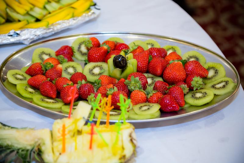 Plate of strawberries and kiwi stock image