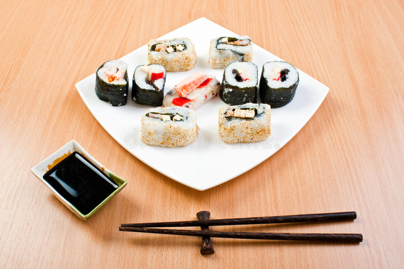 Plate of sushi and chopsticks royalty free stock photo