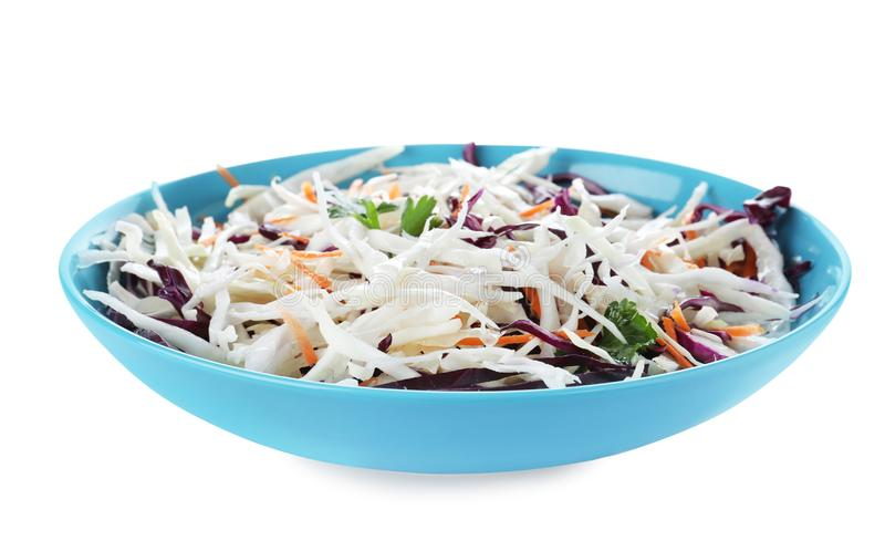 Plate of tasty cabbage salad isolated. On white royalty free stock images
