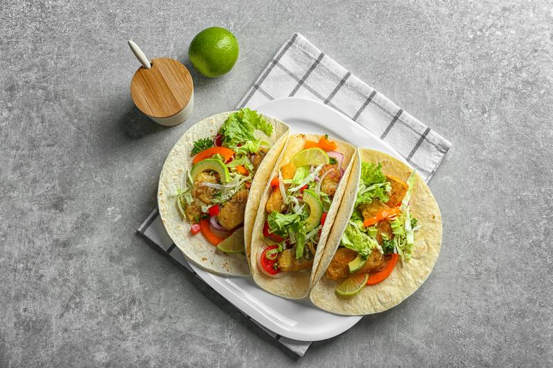 Plate with tasty fish tacos stock image