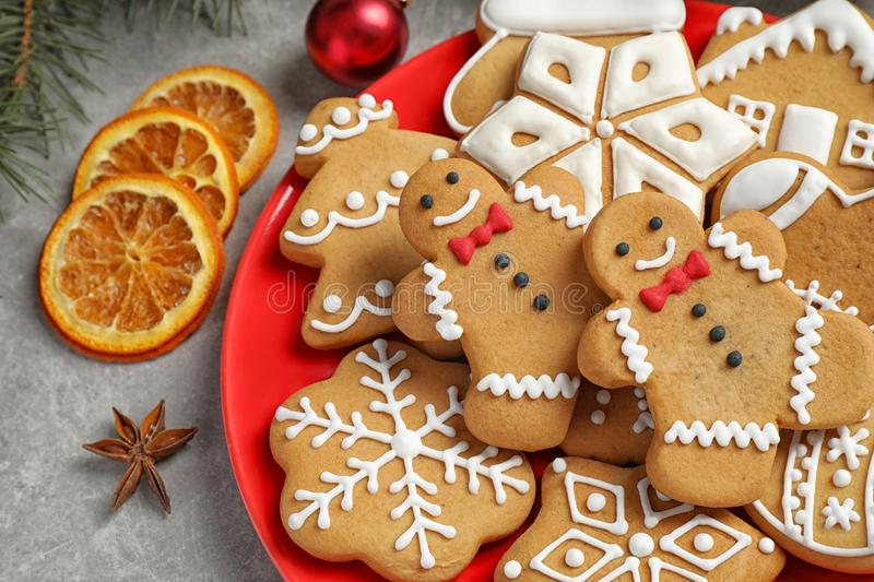 Plate with tasty homemade Christmas cookies on grey table. Closeup stock photos