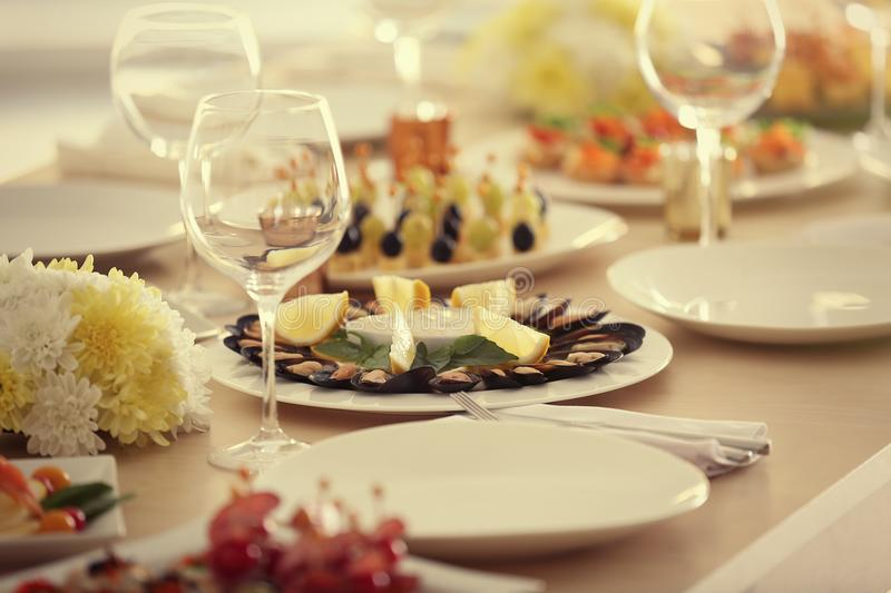 Plate with tasty mussels on table served for holiday buffet. Close up view stock photography