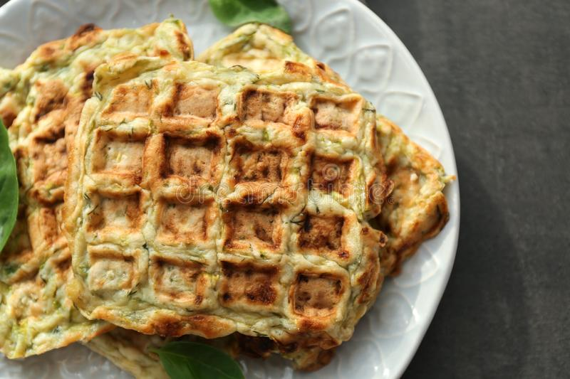 Plate with tasty squash waffles on grey table, closeup stock images