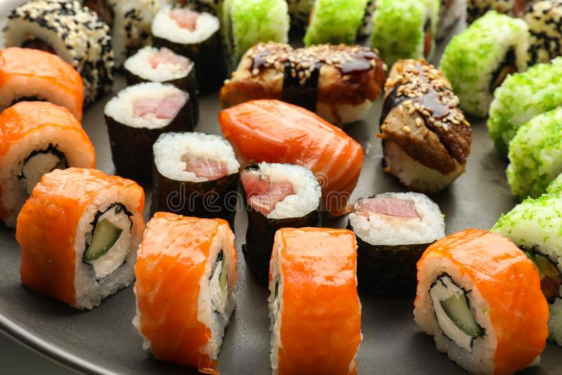 Plate with tasty sushi, closeup stock photo