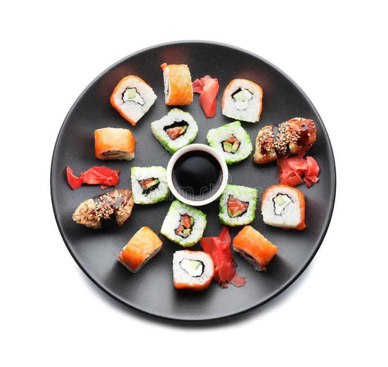 Plate with tasty sushi on white background royalty free stock photos