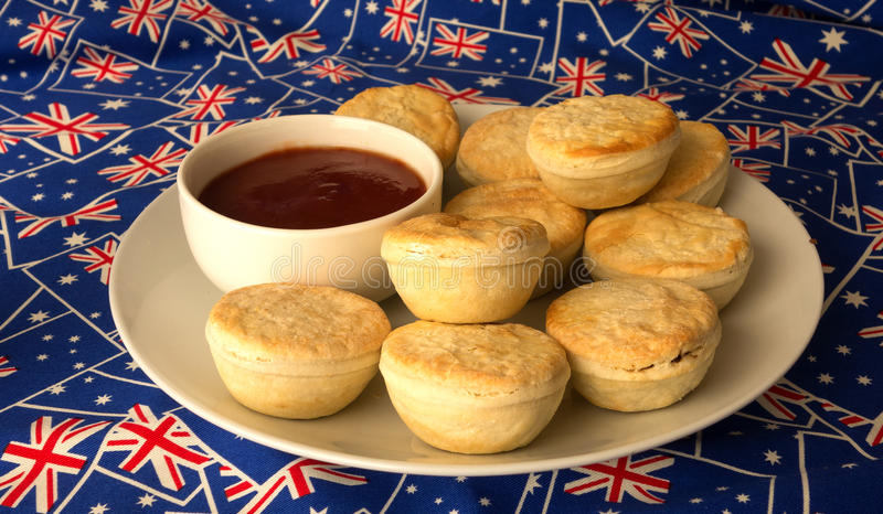 Plate of traditional australian meat pies and tomato sauce for Australian traditional cuisine