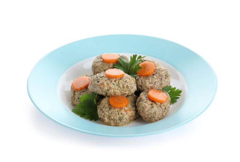Plate of traditional Passover Pesach gefilte fish on white. Plate of traditional Passover Pesach gefilte fish isolated on white royalty free stock photography