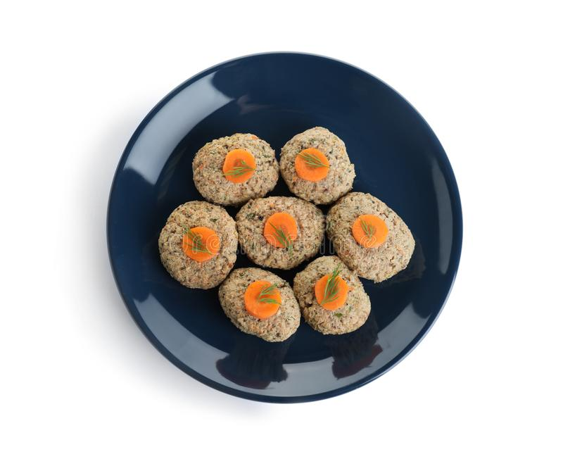 Plate of traditional Passover Pesach gefilte fish isolated on white. Top view stock image