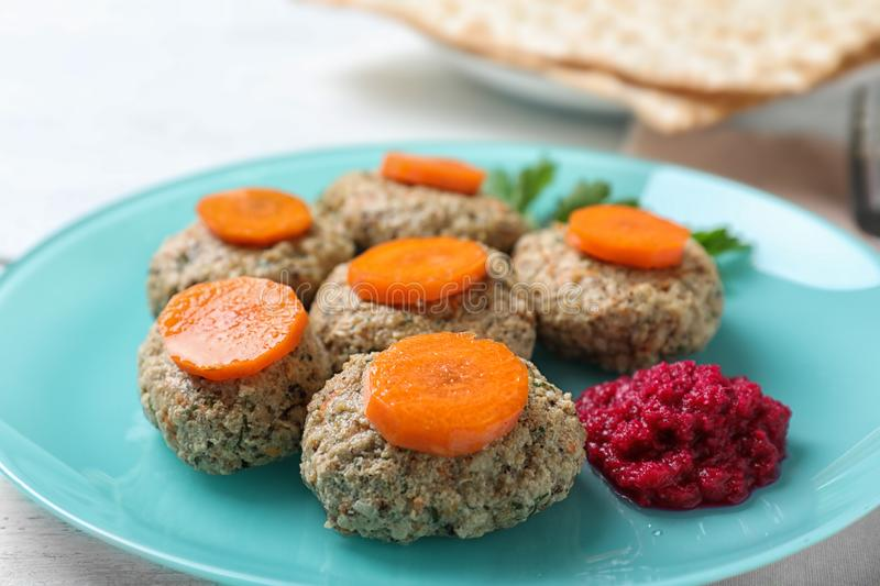 Plate of traditional Passover Pesach gefilte fish on table. Closeup royalty free stock photos