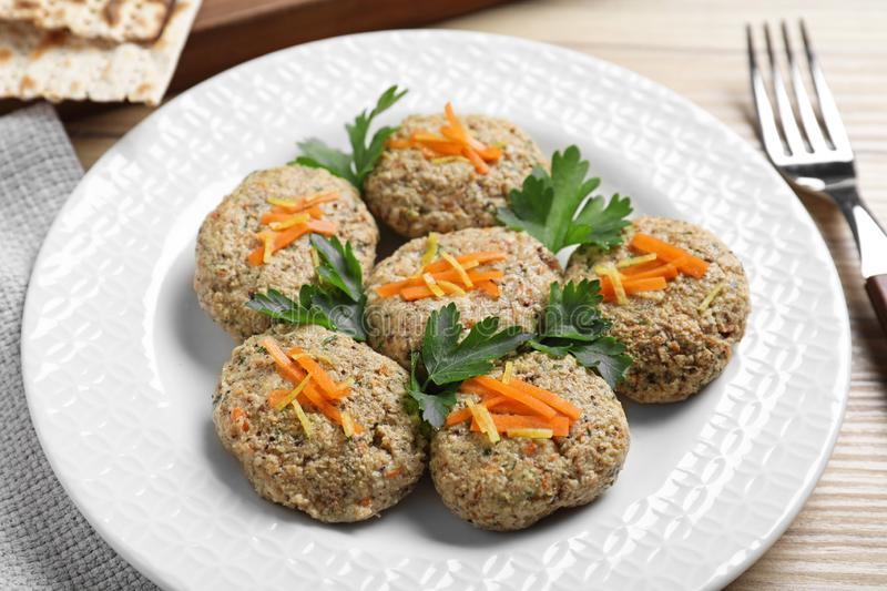 Plate of traditional Passover Pesach gefilte fish on wooden background. Closeup stock images