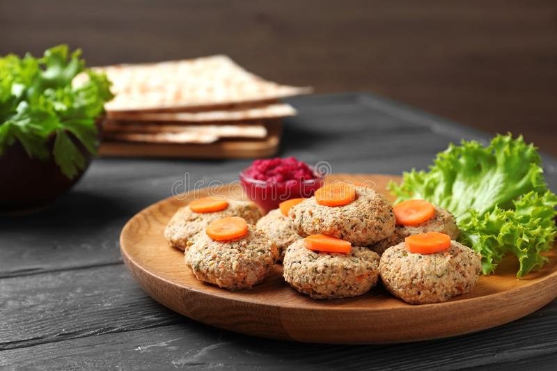 Plate of traditional Passover Pesach gefilte fish. On wooden table royalty free stock images