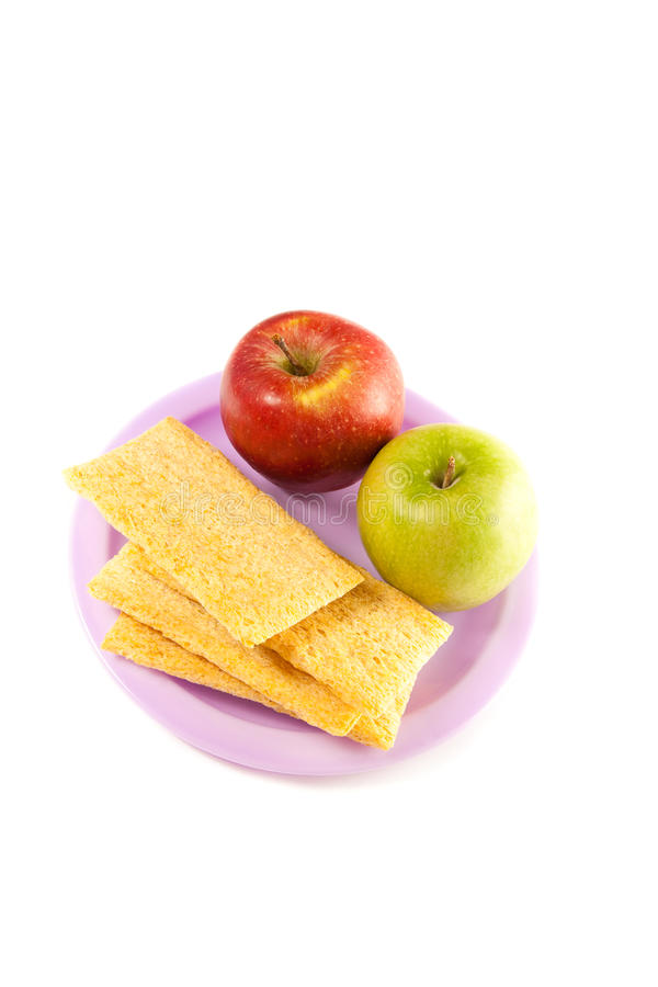A Plate With Two Apple  And Crisps Stock Photos