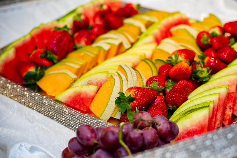 Plate of various sliced fruit stock photo