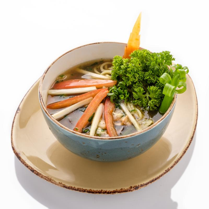 Plate of Vegetarian Soup Ramen with noodles and fresh herbs stock photos