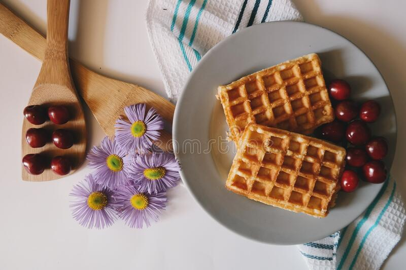 Plate of waffles with cherries stock images