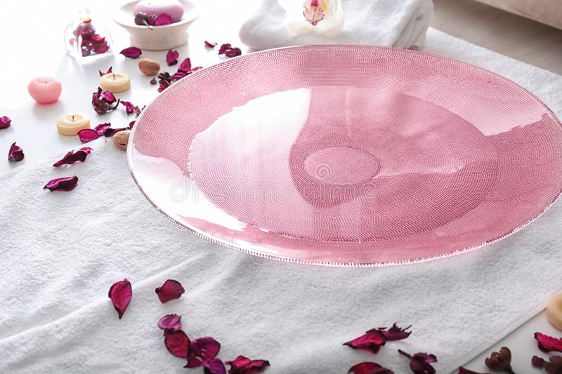 Plate with water prepared for spa pedicure treatment in beauty salon stock photos