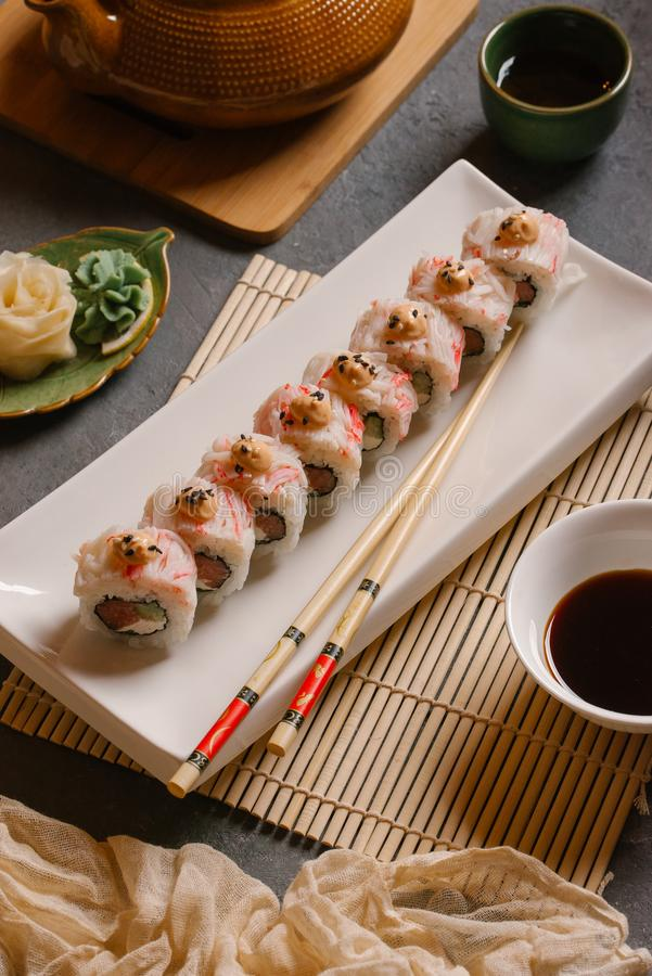 On the plate is white, lined with delicious rolls, sushi, Red, black, Philadelphia sesame stock photo