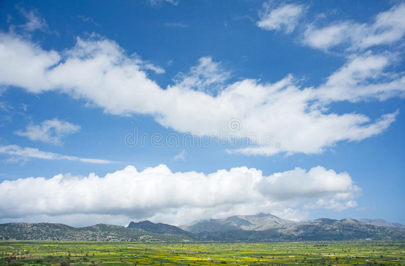 The Plateau of Lassithi, Crete. An image of the Lassithi Plateau in Crete which despite being high up in the mountains is a productive agricultural area and stock photo