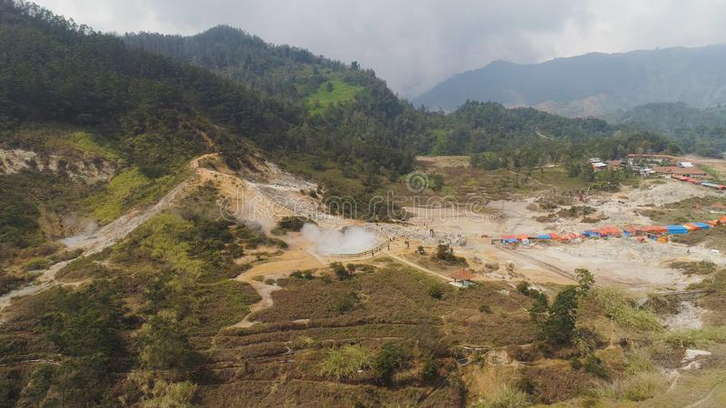 Volcanic plateau Indonesia Dieng Plateau. Plateau with volcanic activity, mud volcano Kawah Sikidang, geothermal activity and geysers. aerial view volcanic royalty free stock photo