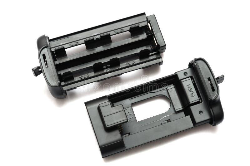 Plateaux verticaux numériques d'une batterie de poignée d'appareil-photo réflexe de lentille simple photo stock